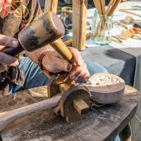 Woodworker demonstrates ladle carving