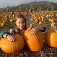 Child with pumpkins